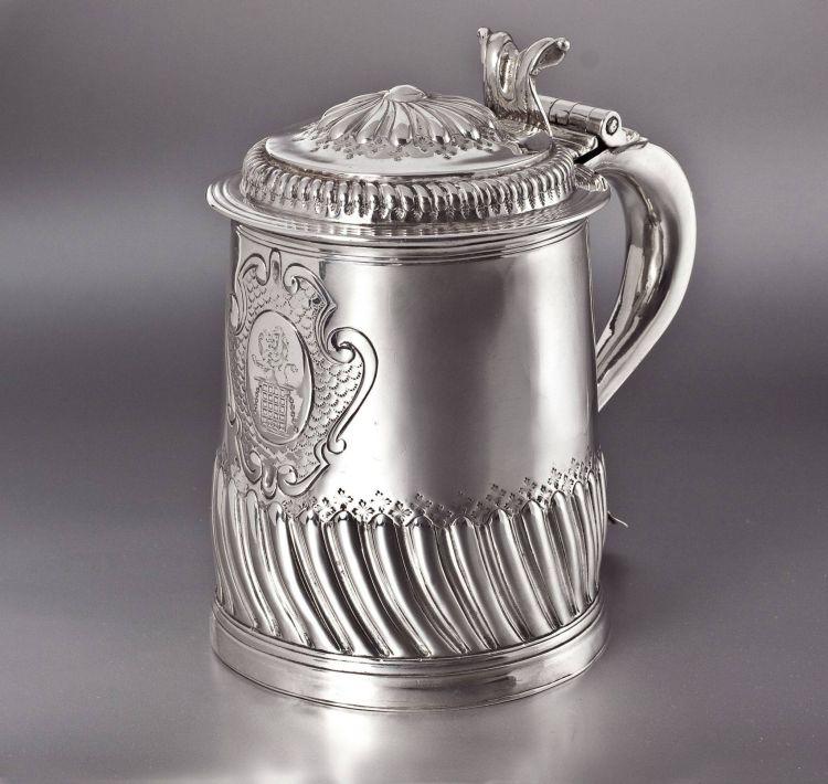 A Queen Anne silver lidded tankard, John Fletcher, London, 1704