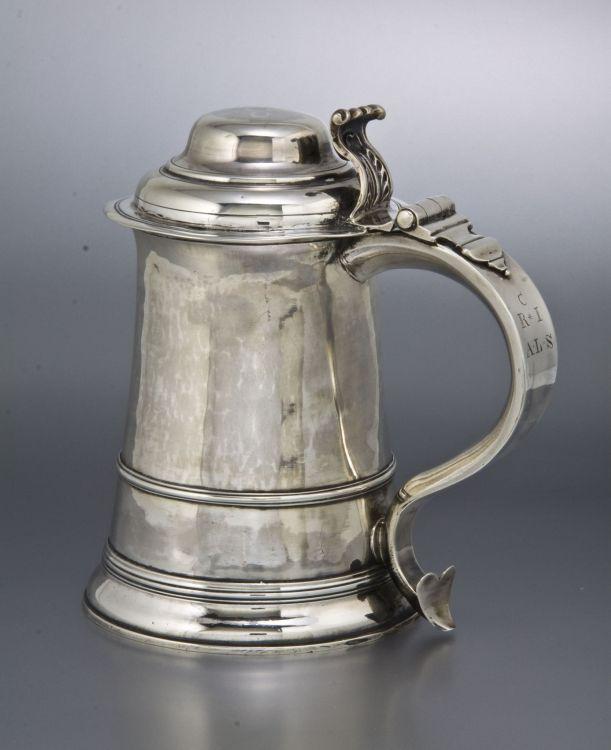 A George III silver lidded tankard, maker's mark TR, London, 1761