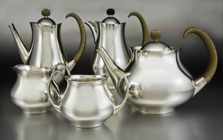 A Mappin and Webb silver five-piece 'Clements' pattern tea and café au lait service, Eric Clements, Sheffield, 1963