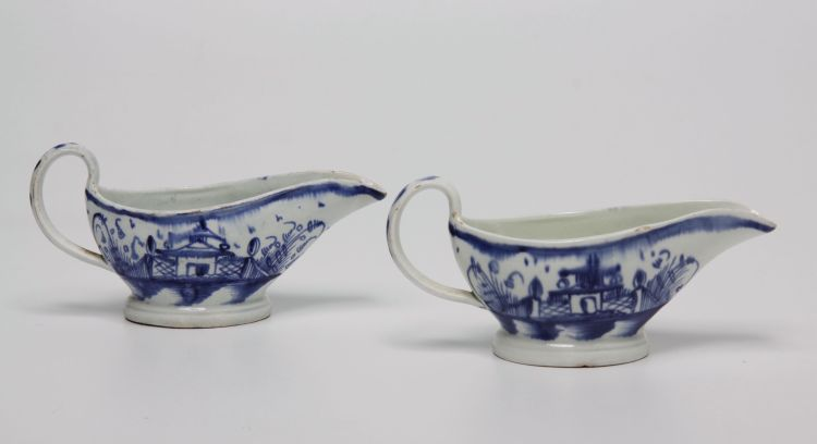 A pair of Staffordshire blue and white sauceboats, circa 1770