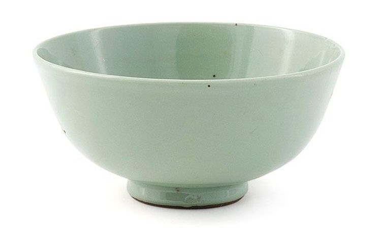 A Chinese celadon-glazed bowl, Qing Dynasty, 18th century