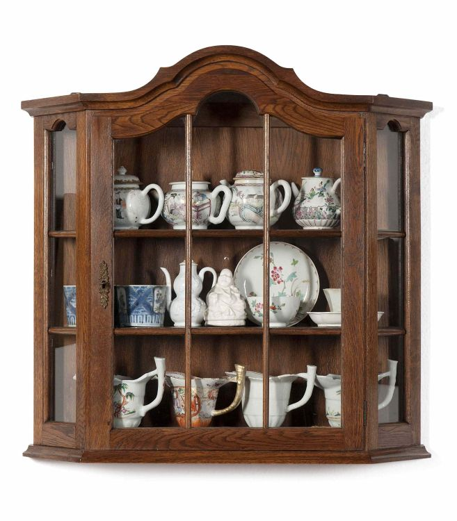 A Dutch oak hanging display cabinet, early 20th century