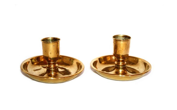 A pair of brass travelling candlesticks, 19th century