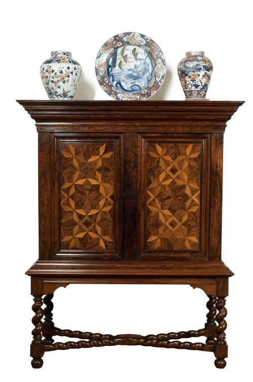 A Colonial rosewood, satinwood, teak and parquetry cupboard-on-stand, 18th century