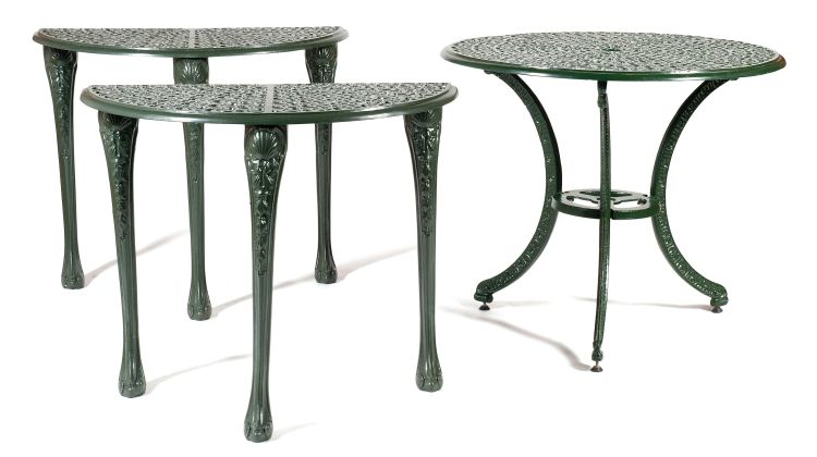 A green-painted wrought iron circular table