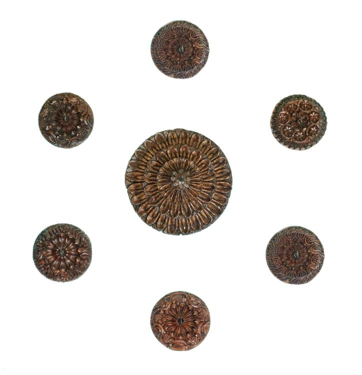 A group of ten Indian carved teak ceiling roses
