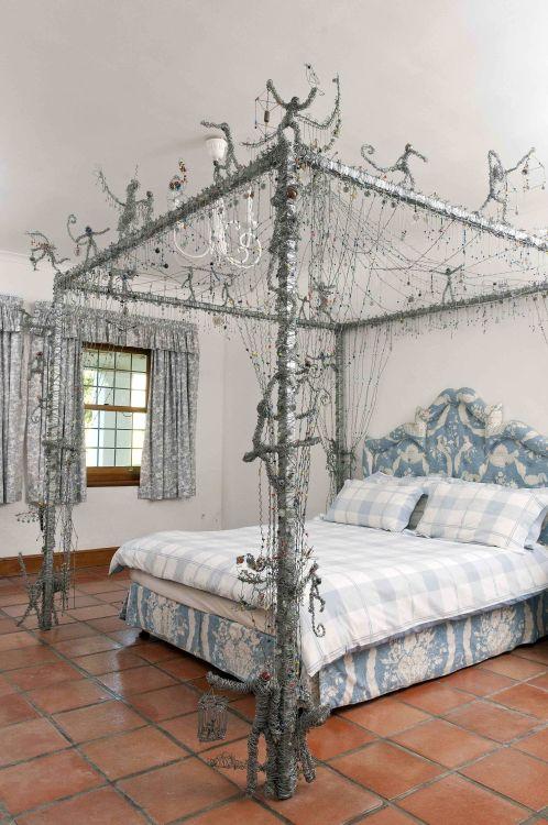 A wire four-poster bed frame, by John van der Veen, modern