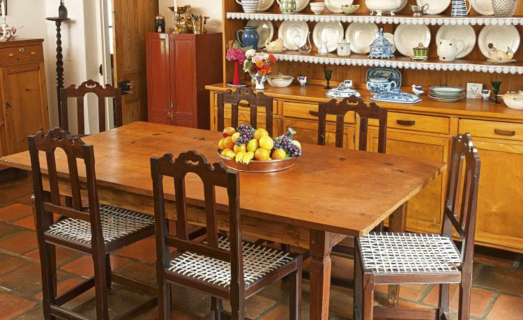 A South African pine and teak dining table, 20th century