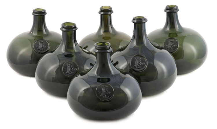 A set of six Shaft-and-Globe green glass bottles, modern