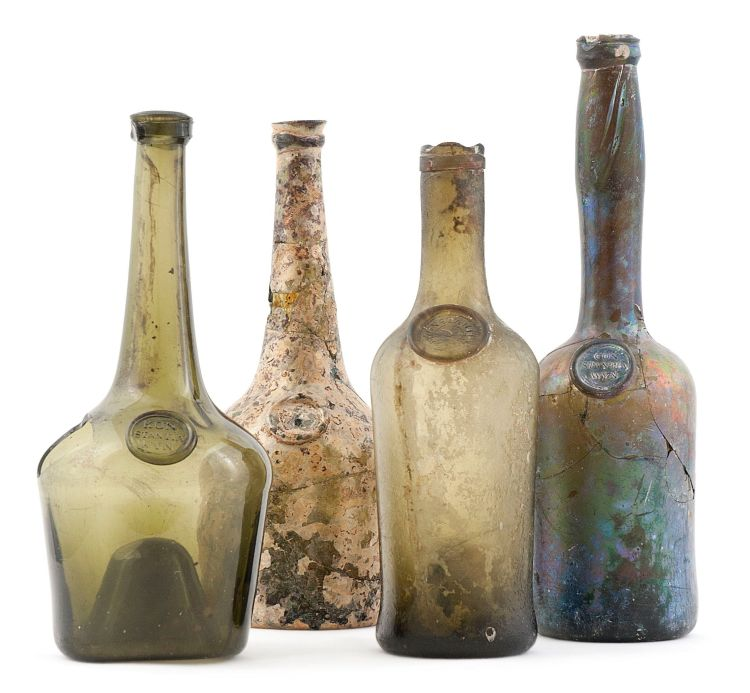 A group of four green glass Constantia wine bottles, 18th century