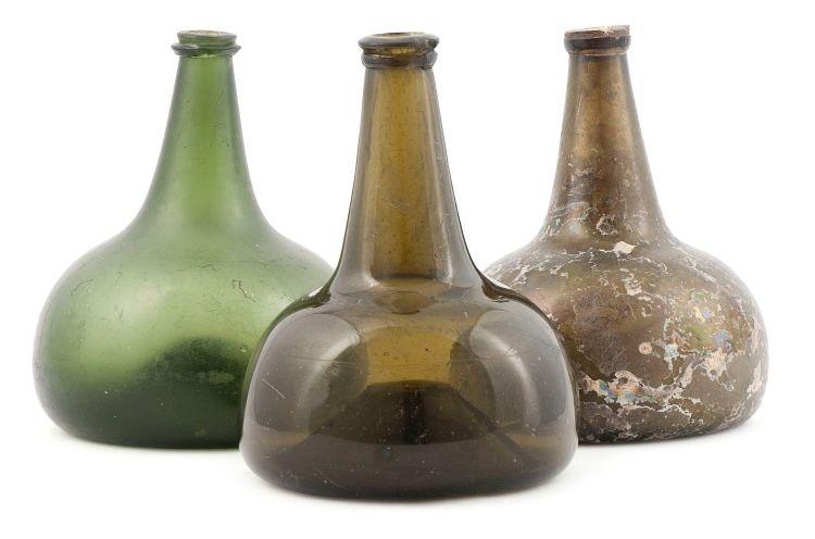 Three Shaft-and-Globe green glass bottles, 18th/19th century