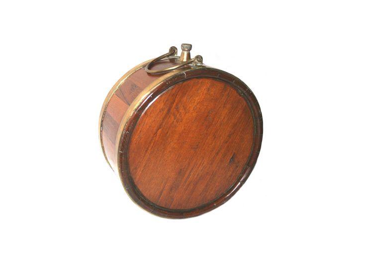 A teak brass-bound water barrel