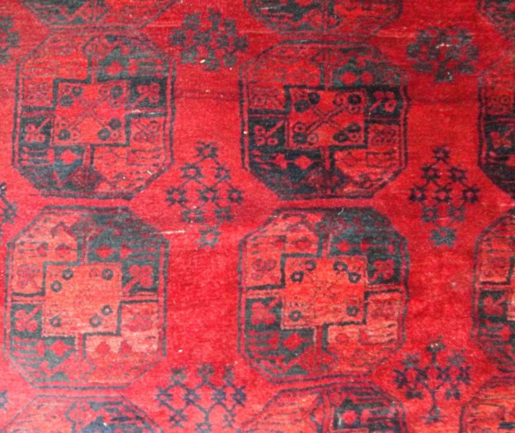 An Afghan carpet, circa 1940