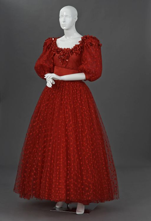 A chrimson spotted tulle two piece ball gown
