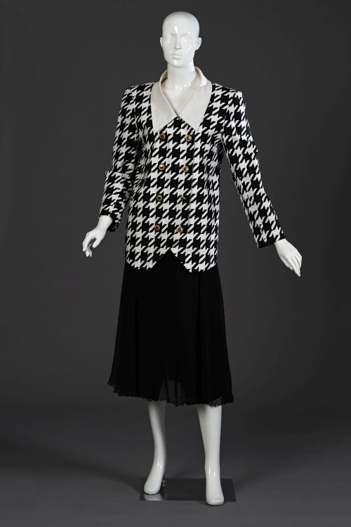 A black and white printed houndstooth check jacket