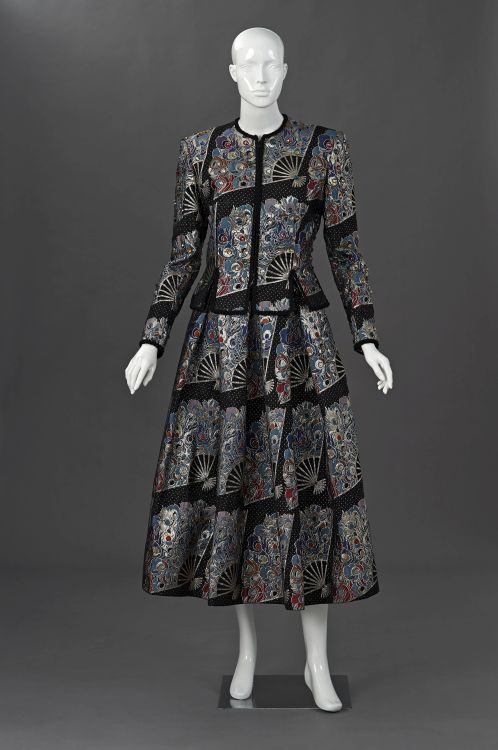 An evening suit in luxuriously woven brocade