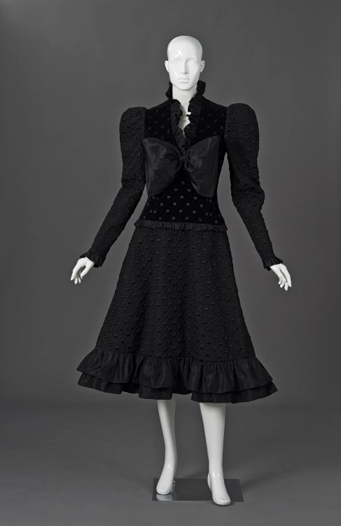An embroided and quilted black velvet and slik taffeta cocktail dress