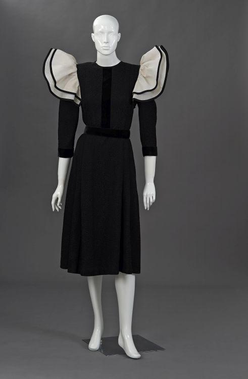 A black cloqué cocktail dress