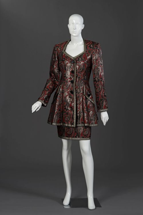 A red, black and gold brocade evening suit
