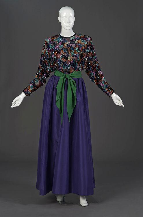 A  multicoloured, bead encrusted, dolman sleeved top
