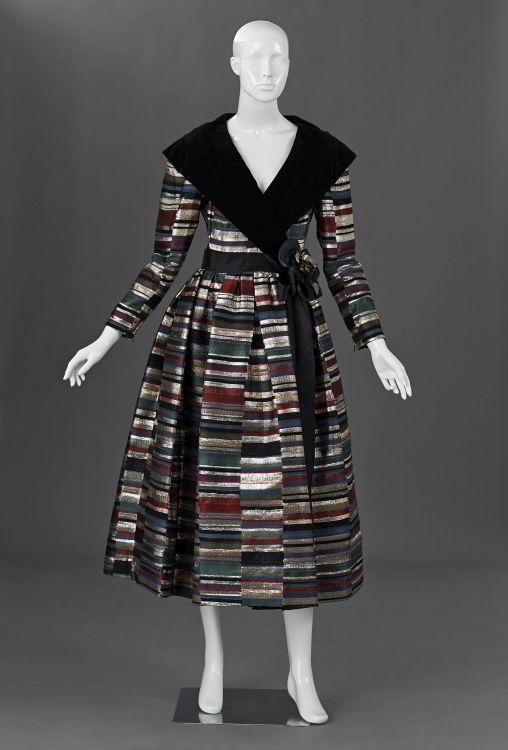 A richly woven brocade evening dress