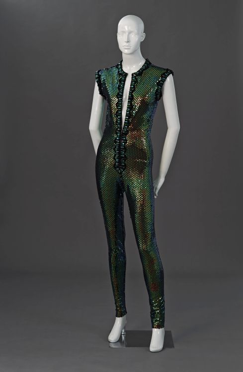 A cat suit in iridescent green stretch sequin fabric