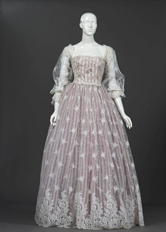 A wedding gown in chantilly lace over pink regency striped acetate taffeta
