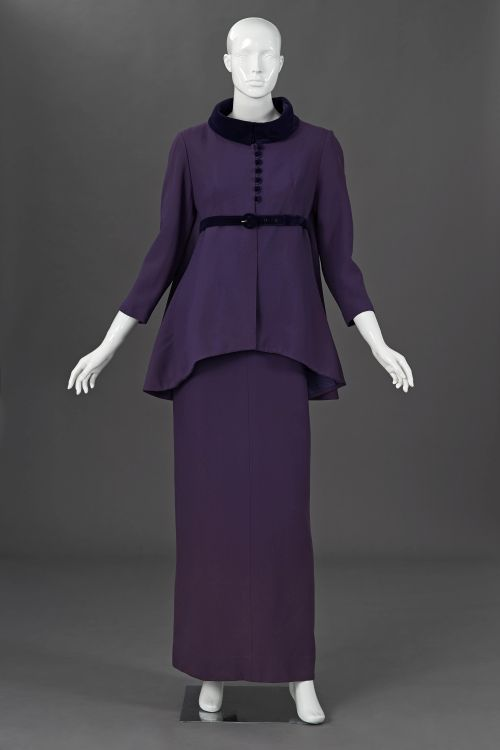 A violet coloured double crepe empire line gala gown and jacket