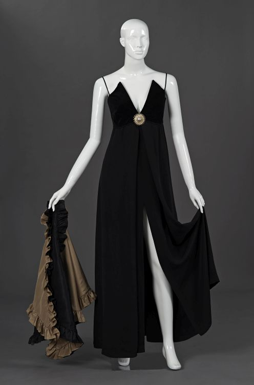 A soft flowing black empire cut evening gown