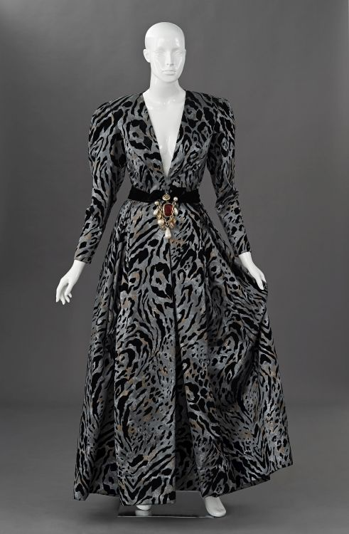 A heavy satin ball gown in heron grey printed with velvet tiger skin design