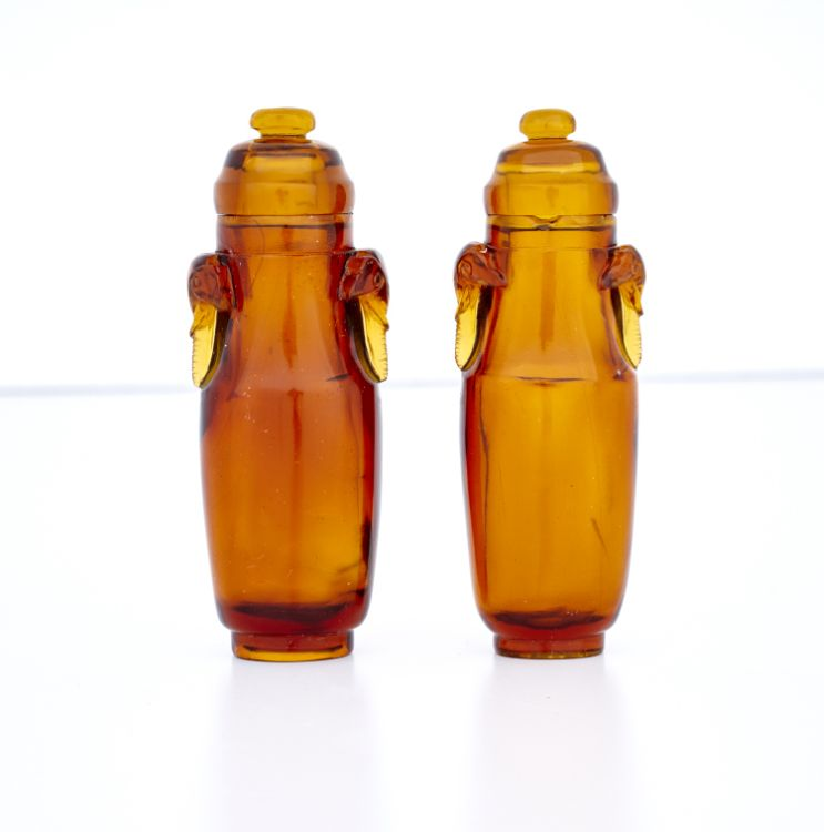 A near pair of Chinese amber-coloured glass snuff bottles, 20th century
