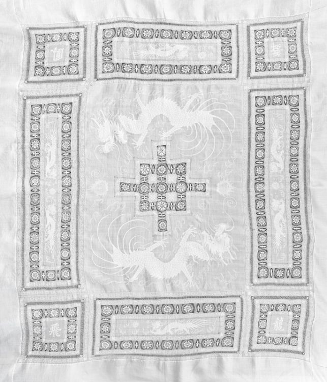 A Chinese embroidered linen and cotton bedspread, circa 1910