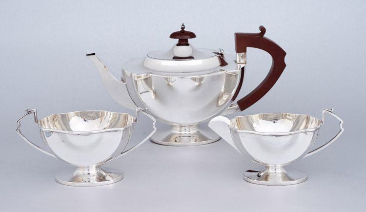 A three-piece George V silver tea set, Ernest W Hayward, Birmingham, 1935