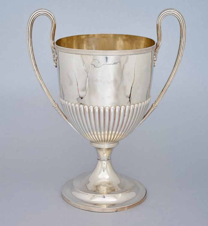 A Victorian silver two-handled trophy cup, Walker & Hall, Sheffield, 1895