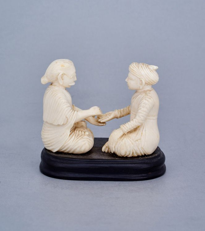 An Indian ivory carving of a palm reader, first half 20th century