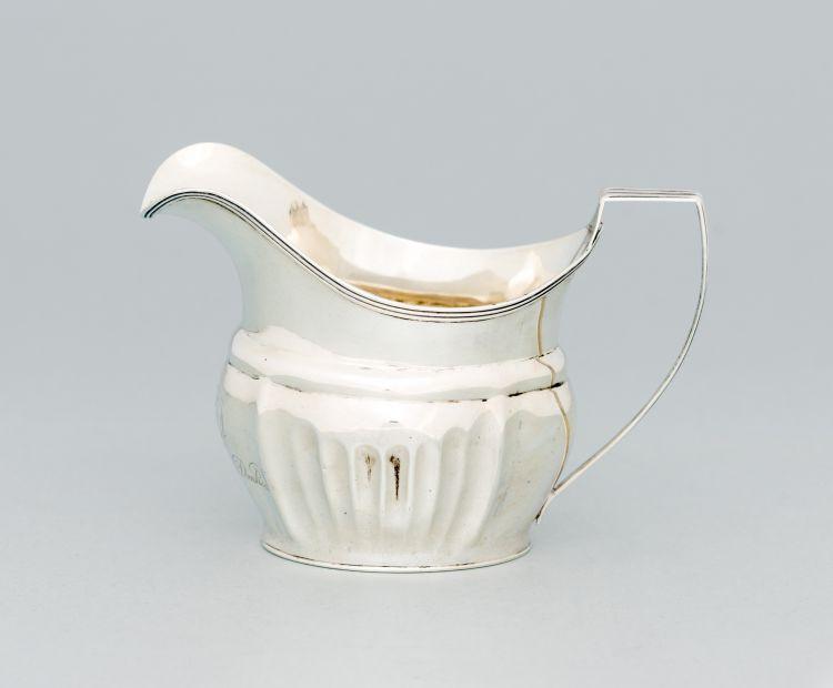 A George III silver milk jug, Samuel Godbehere, Edward Wigan & James Boult, London, 1808