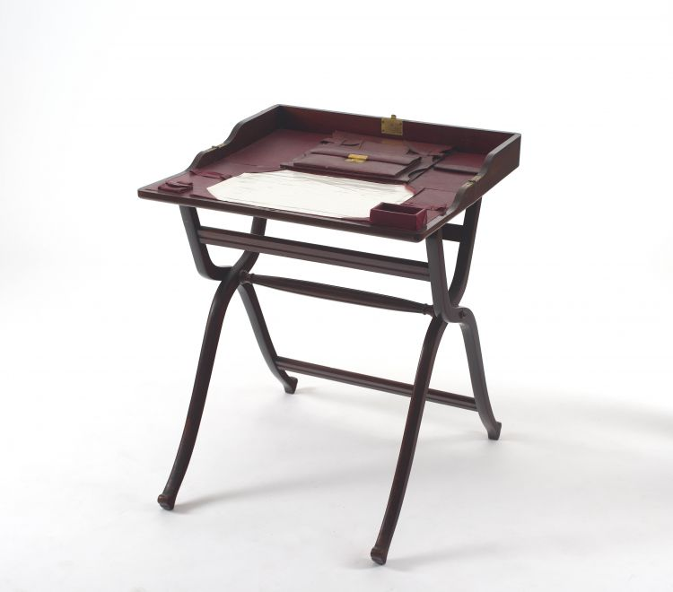 An Edwardian mahogany campaign travelling desk
