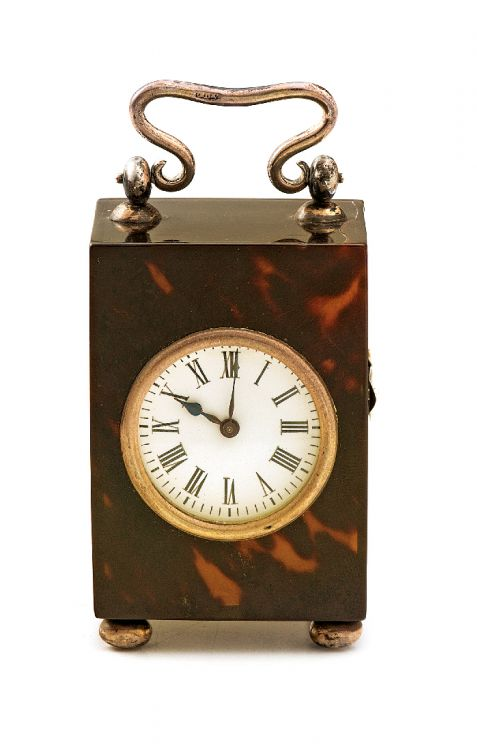 An Edwardian tortoiseshell and silver-mounted carriage time piece, retailed by Carrington & Co.