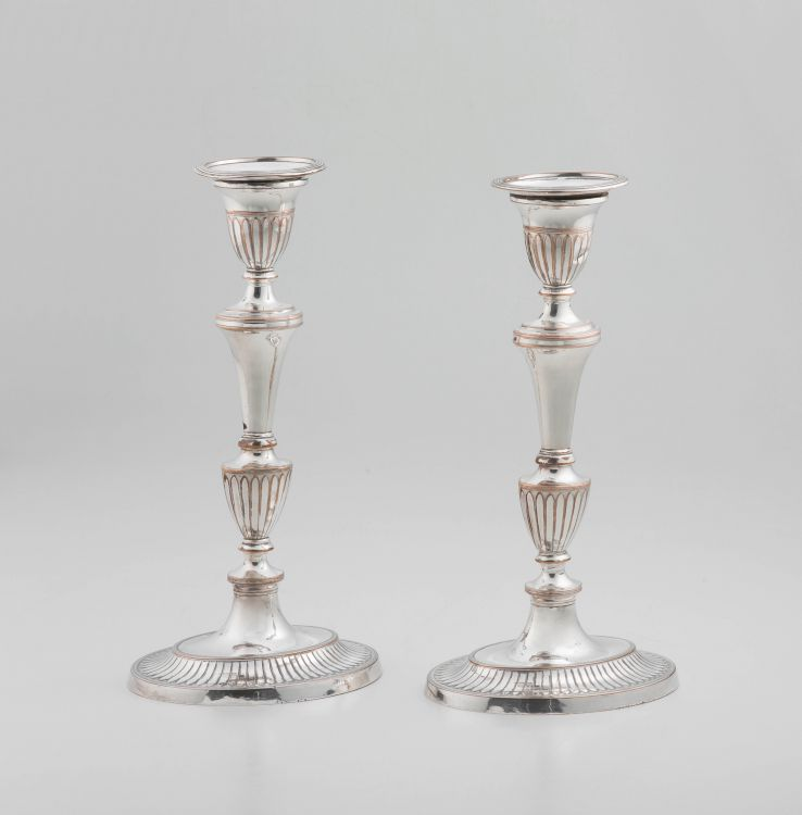 A pair of Sheffield plate neo-classical style candlesticks, 19th century