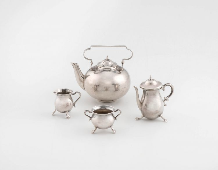 A Dutch silver miniature four-piece tea service, probably Herman Hooykaas, Schoonhoven, The Netherlands, early 20th century, .833 standard
