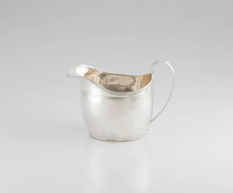 A George III silver cream jug, maker's marks worn, London, 1805