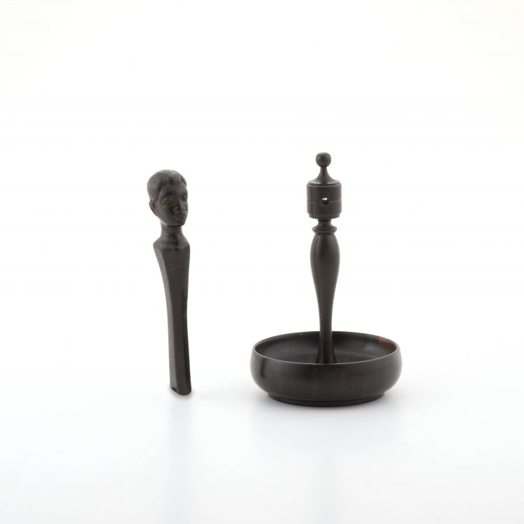A turned ebony figural ring stand, early 20th century