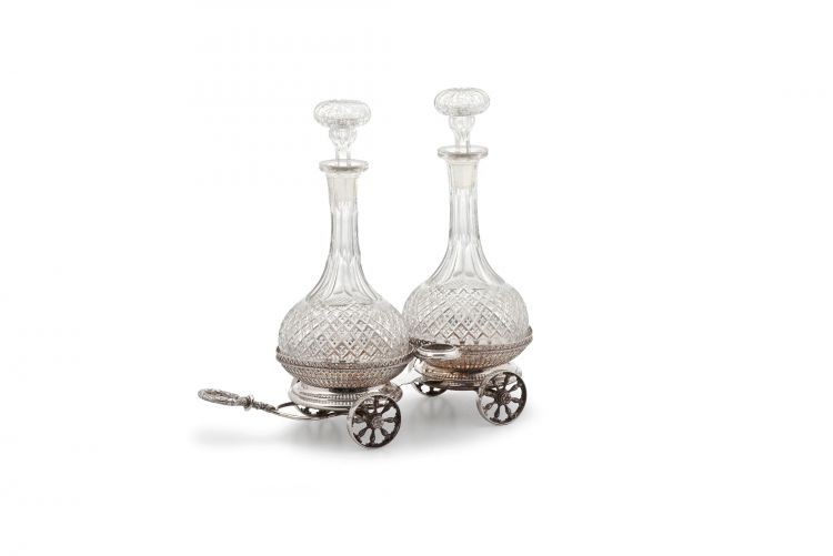 A Sheffield silver-plate double coaster trolley and decanters, maker's initials 'H & Co', 19th century