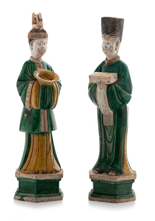 Two Chinese sancai-glazed earthenware figures of attendants, Ming Dynasty, 1368-1644