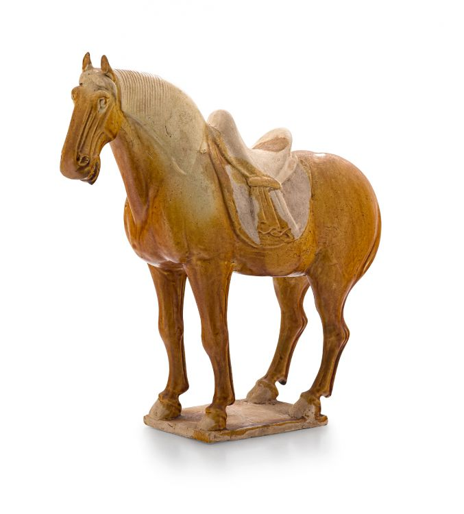 A brown-glazed pottery figure of a horse, Tang Dynasty, 618-907