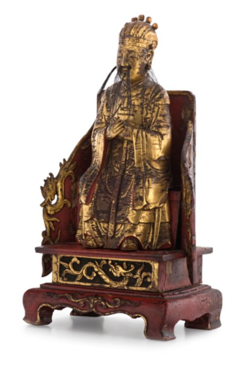 A Chinese lacquered wood and gilt figure of a dignitary, 17th/18th century
