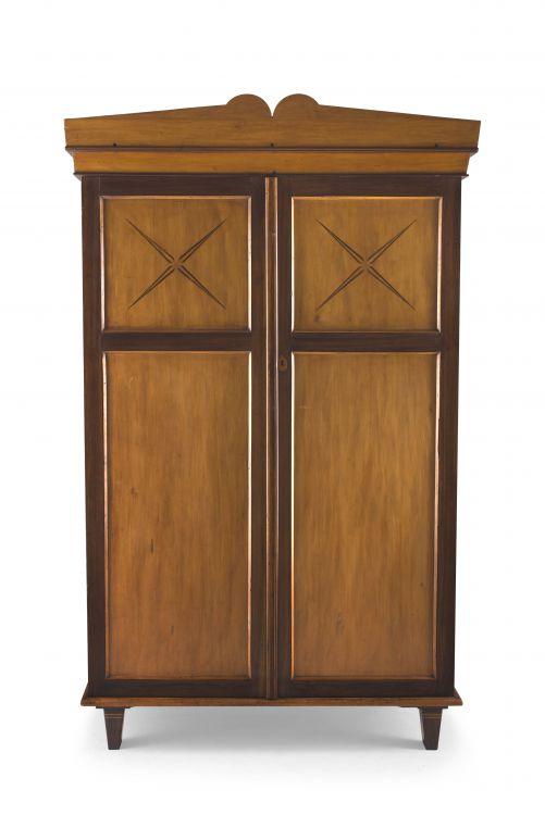 A Cape yellowwood and stinkwood pediment cupboard, 19th century