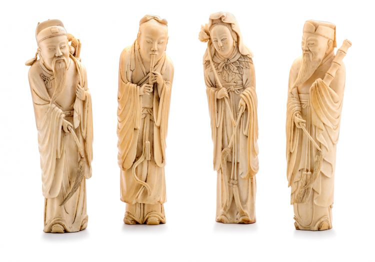 A set of four Chinese ivory figures of Immortals, Qing Dynasty, late 18th/early 19th century