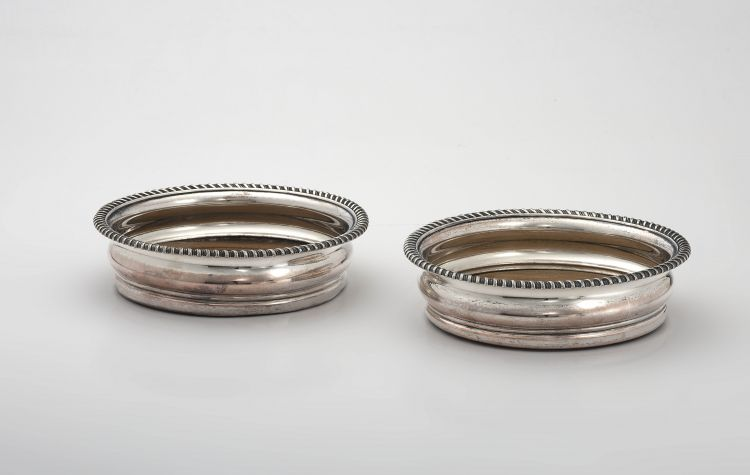 A pair of silver-plate wine coasters, 19th century