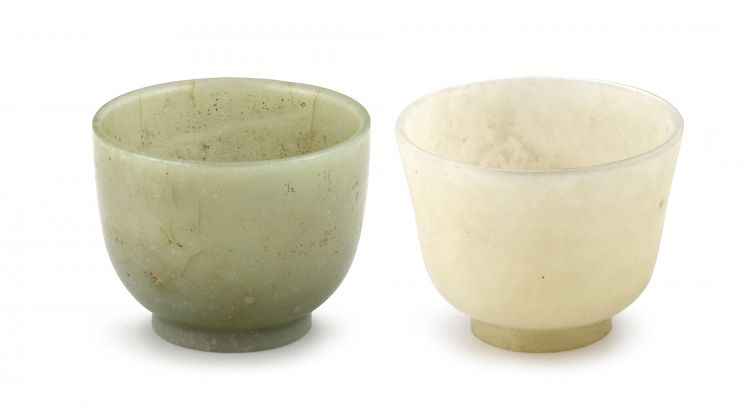 A Chinese celadon carved jade cup, Qing Dynasty, 19th century